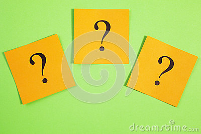 Three Question Marks Orange on Green Background