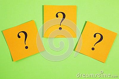 Three Question Marks Orange on Green Background