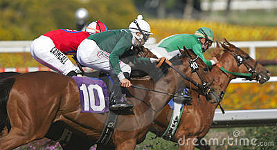 Three Racing Jockeys and Horses Editorial Stock Image