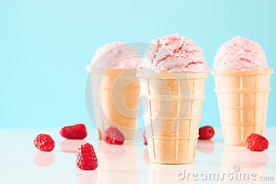 Three raspberry ice cream cones