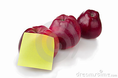 Three red apples with stiker note
