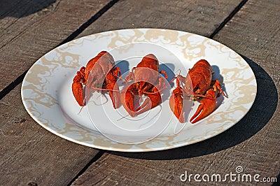 Three red boiled  crawfish.