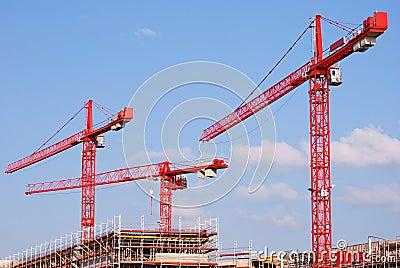 Three red cranes