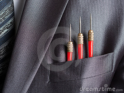 Three red darts in businessman suit pocket