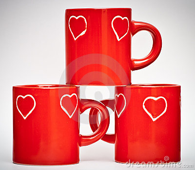 Three red mugs with love signs