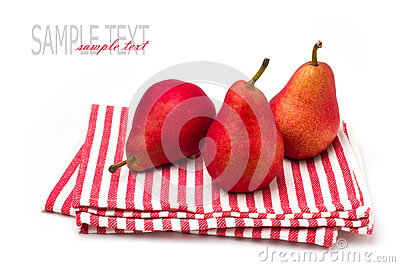 Three red pears on striped tablecloth
