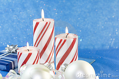 Three red striped Christmas candles
