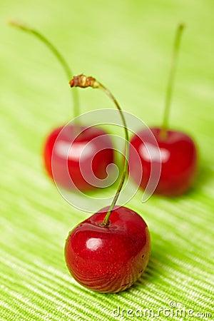Three red sweet cherries