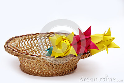 Red and yellow paper tulips in a basket