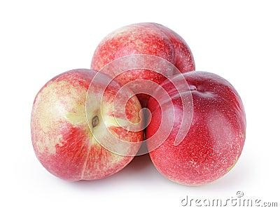Three ripe nectarines