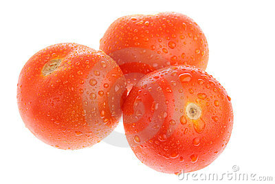 Three ripe tomatoes with dew isolated on white