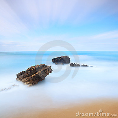 Three rocks seascape. Long exposure photography.