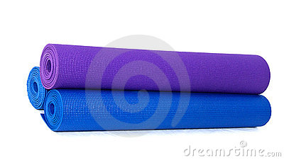Three rolled exercise yoga  mats stacked on white