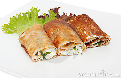 Three rolled pancakes with cheese