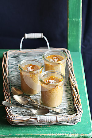 Free Three Salted Caramel Pots De Creme On A Rustic Tray Royalty Free Stock Images - 62388589