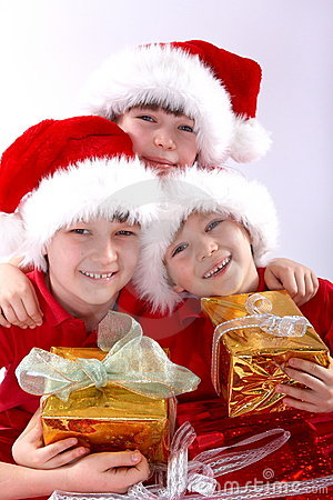 Three santa kids with gifts