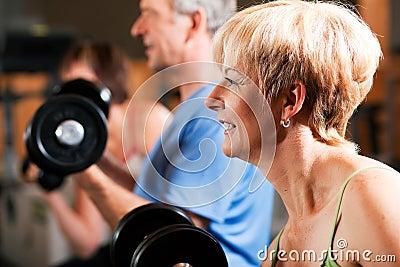 Three senior people in gym