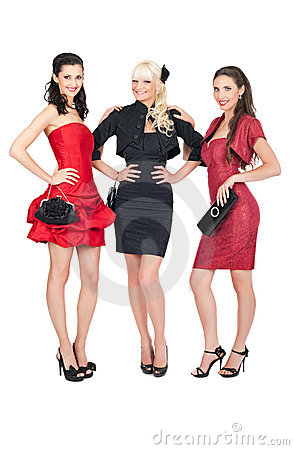 Three sexy girls posing in fashion dresses