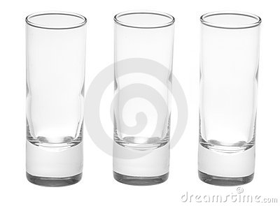 Three shot glasses on white