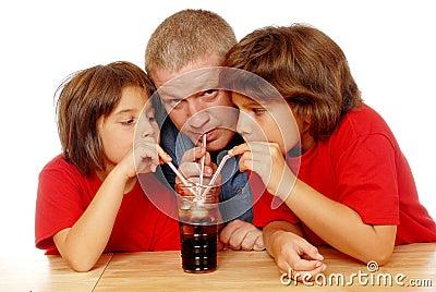 Three Sipping Soda