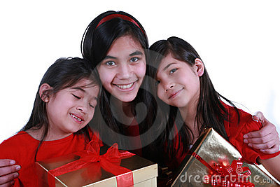 Three sisters holding presents