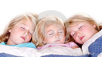 Three sisters sleeping in bed