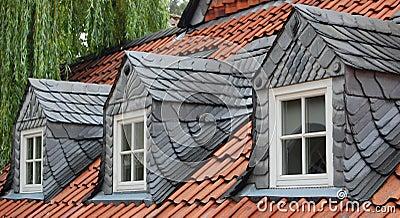 Three slate dormer windows