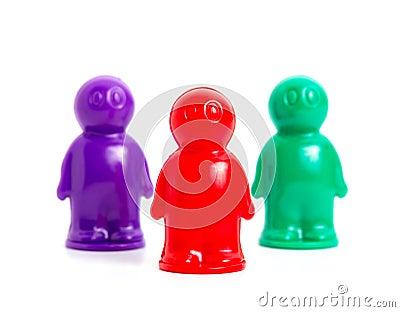 Three small toy businessmans