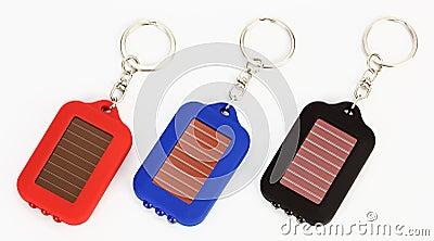Three small trinket LED torch
