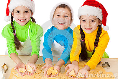 Three smiling kids showing dough