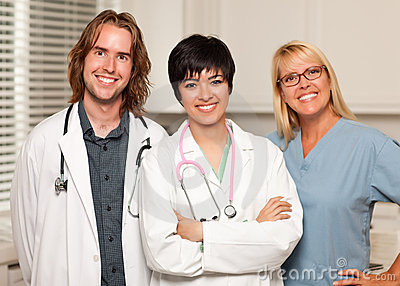 Three Smiling Male and Female Doctors or Nurses