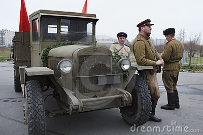 Three soviet soldiers standing near army lorry Editorial Stock Photo