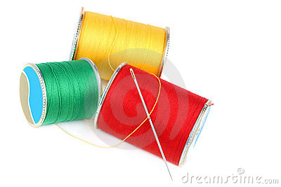 Three spools of thread and needle