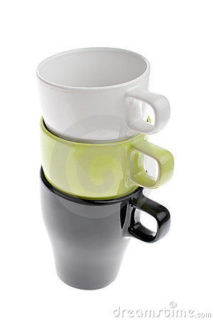 Three stacked white green and black coffee cups