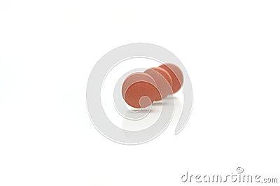 Three Standing Brown Pills