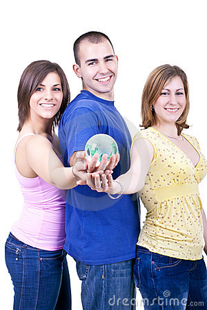Three students holding globe