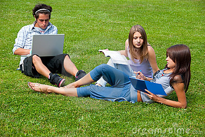Three students studying outdoors