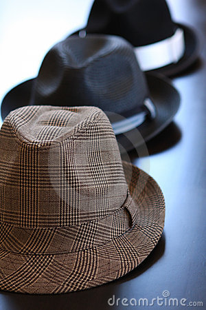 Three Stylish Hats On Table