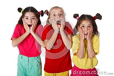 Three surprised little girls