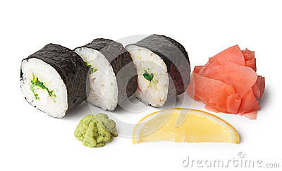Three sushi, wasabi, gringer and lemon