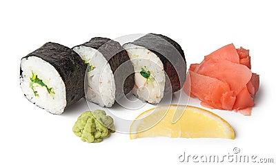 Three sushi, wasabi, gringer and lemon