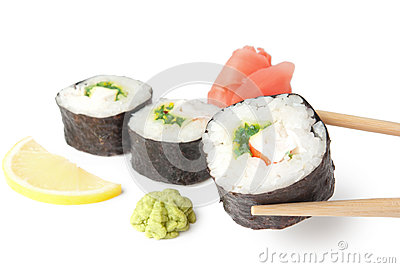 Three sushi, wasabi, gringer, lemon and sticks