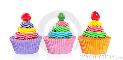 Three sweet colorful cupcakes