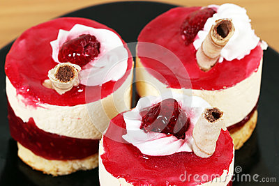 Three sweet raspberry cakes Stock Photo