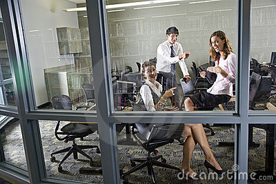 Three teachers meeting in library computer room