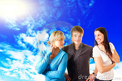 Three teen friends outdoor, over the blue sky