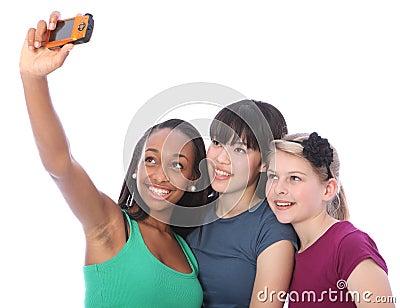 Three teenage girl friends fun with camera selfie