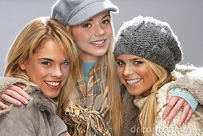 Three Teenage Girls Wearing Knitwear In Studio