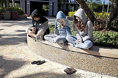 Three Teens Sitting Together