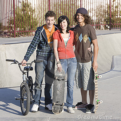 Three teens at skatepark